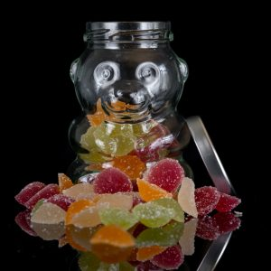 CBD Gummies in a glass bear jar - Emerald Dragon CBD